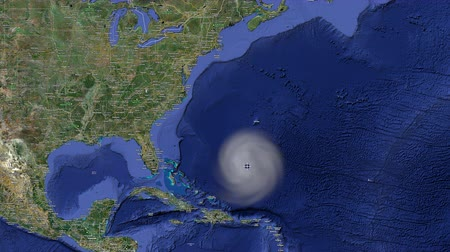 keleti : A hurricane weather tracking system shows a forming hurricane off the coast of Florida as its size increases to hit the entire eastern seaboard. Stock mozgókép
