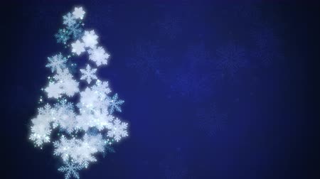 télen : Animated white Christmas tree made up of snowflakes poised against a beautiful blue winter background Stock mozgókép