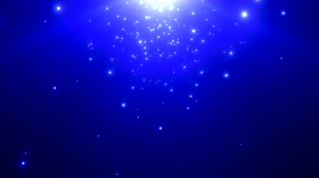 разброс : Bright light particles emitted against a blue background. Стоковые видеозаписи
