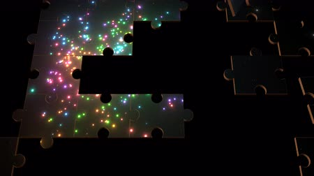 puzle : Multiple jigsaw puzzle pieces forming randomly show an animated fireworks display against a night sky. Wideo