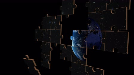 jigsaw : Jigsaw puzzle pieces randomly form to show an animation of earth rotating in space framed by stars