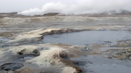fumaroles : Natural steam rising from volcanic vents in the earth at Hverir in Iceland near Myvatn Lake Stock Footage