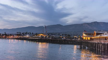 A day to night time-lapse of Stearns Wharf in Santa Barbara shows the pier and shoreline come to life as day becomes night.