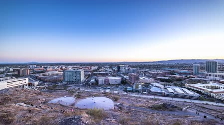 A day to night overlooking Arizona State University campus grounds and community