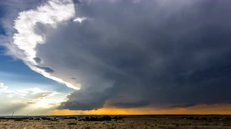 Large, powerful tornadic supercell storm moving over the Great Plains during sunset, setting the stage for the formation of tornados across Tornado Alley.