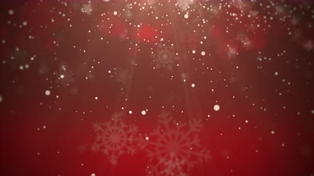 Animated snowy Christmas background on red with white bokeh. Great for use as is to celebrate the holidays or clip can be used with placement of copy for marketing and messaging.