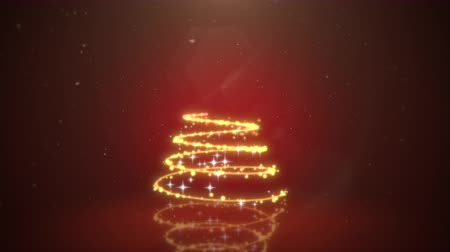An animated golden light Christmas Tree forms on a festive red background and falling snow. Stok Video