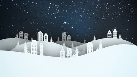 An animated Christmas city scene at night shows snow falling against a dark, festive sky and white city.