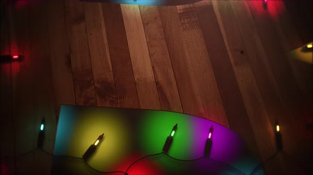 üdvözlet : Festive Christmas lights blinking against a wooden background provides a warm preview to holiday messaging and even as a design element where theres plenty of space for copy in advertising seasonal marketing.