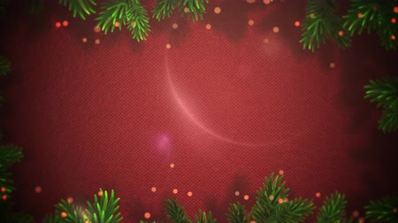 czerwone tło : Animated Christmas frame made of holly zooms slowly out while red festive dots form around the holly.  Great for use as is to celebrate the holidays or clip can be used with placement of copy for marketing and messaging.
