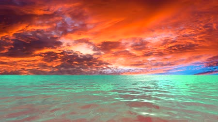 A glimmering tropical ocean with light flickering off the surface during a dramatic sunset
