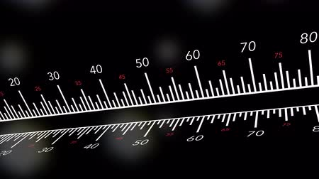 bitola : An animated straight ruler against bokeh background for use as a school, math or measurement theme. Stock Footage