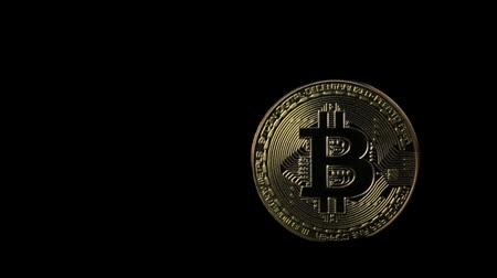 стоимость : Light moving on a bit coin crypto currency on a black background