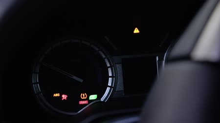 Modern car dashboard gauges lighting up when car is started.