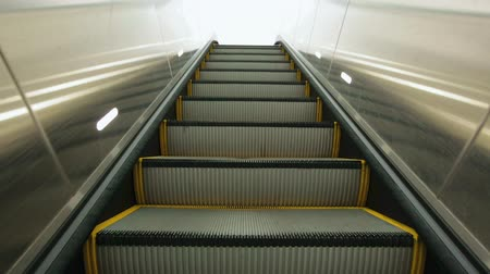 corrimão : Point of View of escalator stairs moving up from underground to the outside