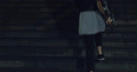 crossway : Girl teenager going at night from the underpass. Young caucasian woman with skateboard in dark underground tunnel. Urban city lifestyle. 4K video shooting by handheld gimbal Stock Footage