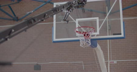 A professional videographer taking video shots of basketball in gym or playground. Slow motion 4k raw footage 60 fps