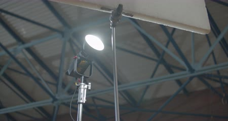 Studio light shines on a reflector. video shots in gym or playground