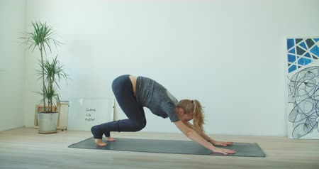 energy balance : healthy yoga woman. Fitness lifestyle exercising in studio stretching beautiful body training