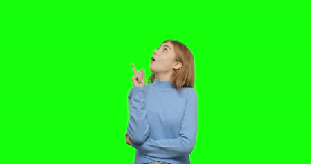 pensiero positivo : Thinking girl showing thumb up. Young pretty woman on green screen background, Chroma Key 4k video footage slow motion 60 fps