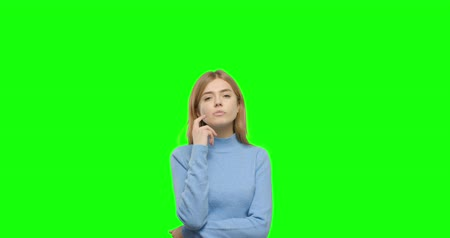 思考 : Thinking girl . Young pretty woman on green screen background, Chroma Key 4k video footage slow motion 60 fps 動画素材