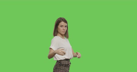 söylemek : Serious young woman showing go away signs isolated on Green Screen, Chroma Key. 4k video footage slow motion 60 fps Stok Video