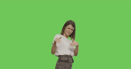 göz alıcı : Serious young woman showing go away signs isolated on Green Screen, Chroma Key. 4k video footage slow motion 60 fps Stok Video