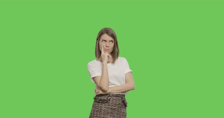 pensiero positivo : Thinking girl showing thumb up. Young pretty woman isolated on green screen background, Chroma Key 4k video footage slow motion 60 fps