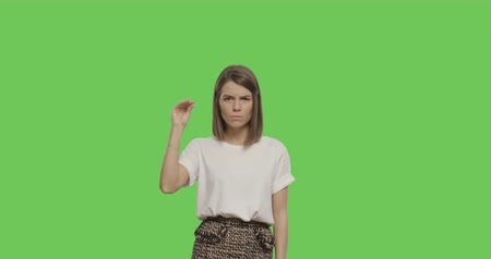 rejeitar : Serious young woman saying shut up isolated on Green Screen, Chroma Key. 4k video footage slow motion 60 fps Stock Footage