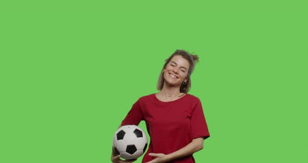 bounce : Funny pretty girl with soccer ball in her hands call to play. Young woman showing sign finger hand gesture . 4k footage shot on chroma key green background.