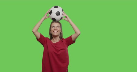 bounce : Funny pretty girl having fun with soccer ball in her hands, appearing ready to play. 4k footage shot on chroma key green background.