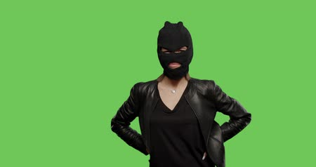 haydut : sexy woman in balaclava - crime and violence on green background . Naughty girl in burgal mask having fun . Chroma Key. 4k raw video footage slow motion 60 fps