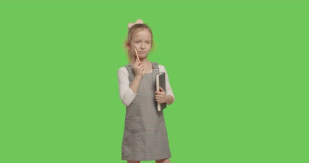 minor : young businesswoman child thinking of idea and holding notebook. girl worried about something on Green Screen. 4k raw video footage slow motion 60 fps Stock Footage
