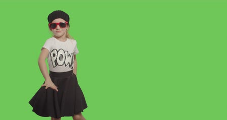 chmiel : young beautiful girl dancing hip hop, dancehall, street dance over green screen background. Happy smiling child having fun on Chroma Key. 4k video footage slow motion 60 fps