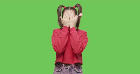 emmek : Young woman with big red lollipop close her face by hands over green screen background. Cheerful sexy girl suck and lick tasty candy, wink and flirt on chroma key