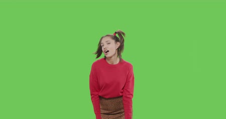 Happy smiling woman dancing and having fun isolated on Green Screen, Chroma Key. 4k raw video footage slow motion 60 fps Stock mozgókép