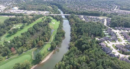 тройник : Flying Over Golf Course and River Towards Bridge