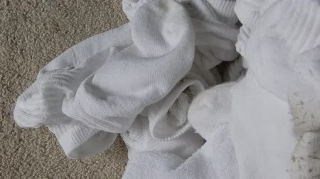 cipőfűző : 4K Closeup Dirty White Socks Pile Pan Left To Right Stock mozgókép