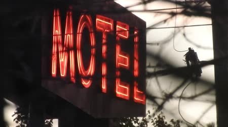 országúti : Red Neon Motel Sign With Silouette Of Trees
