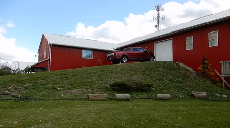 hayloft : 4K White House Red Farm House With Red Truck On Hill Pan