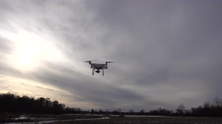 stable fly : 4K Drone Flying In Field With Snow Against Purple Gray Sky