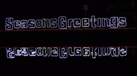 festividades : 4K Seasons Greetings Phrase With Water Ripples And Neon Stars