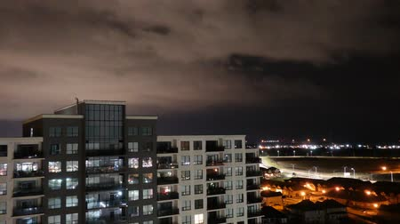 oroszország : Timelapse Apartment Building with Rainy Storm Clouds At Night