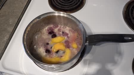 mürver : 4K Oatmeal With Fruit & Cherries On Stove Cooking