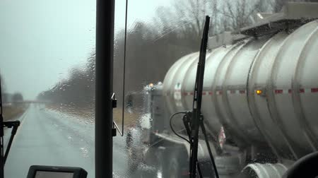 tazı : Passing Oil Tanker On Highway On Rainy Day In Bus Slow Motion