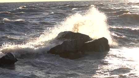 agua : Slow Motion Waves With Sunlight Crashing Against Rock In Ocean 002 Stock Footage
