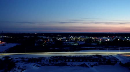 cor de malva : Timelapse Snow Covered Town Aerial During Sunset Stock Footage