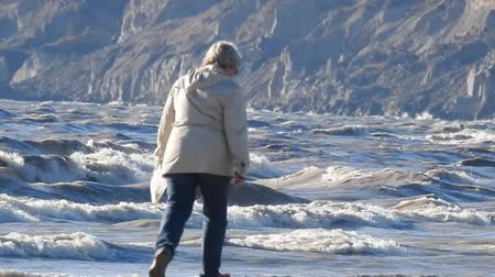króliczek : Woman In Jacket Walking Along Beach Picking Up Things 002 Wideo