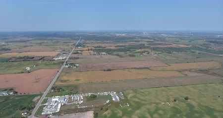 irrigate : Panorama Aerial View Of Small Town and Farmland Stock Footage