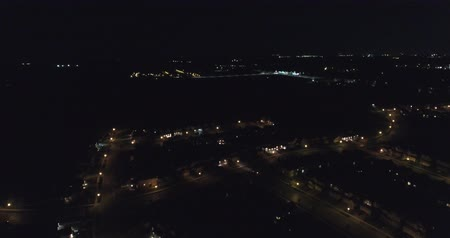 освещенный : Car Driving At Night On Road Aerial Drone Shot In Neighborhood
